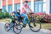 Family Cycling, Father With Happy Kid Riding Bike Outdoors poster