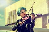 Music on violin by woman perform in park outdoor. Girl performing jazz on city street . Color tone o poster