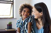 Close up face of latin woman playing with her african son. Happy young son feeling loved by mother.  poster