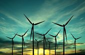 picture of wind-turbine  - wind turbine farm over sunset - JPG