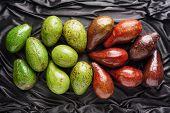 Постер, плакат: Colorful Fresh Ripe Avocados On Dark Background Healthy Eco Food