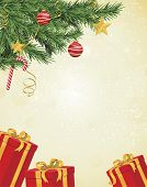 Christmas tree branches in corner over hanging pale yellow background with red and gold gifts undern