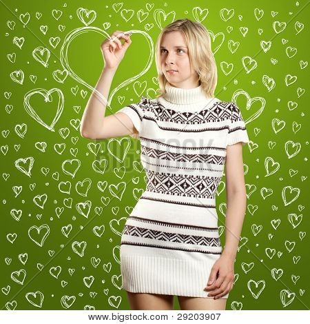 woman drawing heart shapes on valentine day