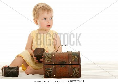 Little Girl Playing Wooden Chests