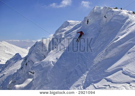 Freeride Skiing With Blue Sky