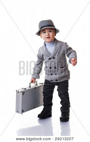 Baby boy holding silver suitcase.