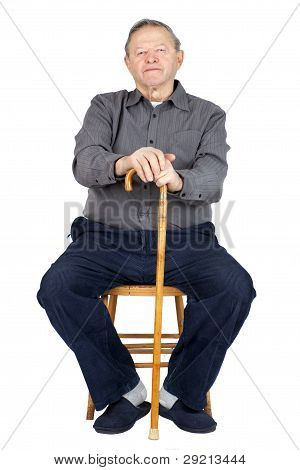 Senior Man With Cane Sitting