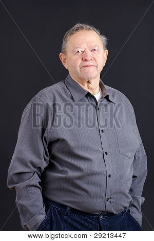 Old Man Hands In Pocket Over Black