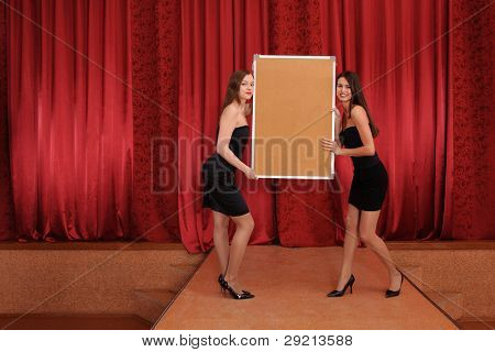 two girls hold empty board. may be use like background for your info
