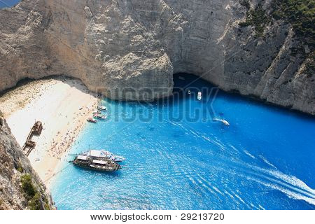 Navagio - the most famous beach on Zakynthos island with shipwreck and anchoring boats (Greece, Ionian islands)