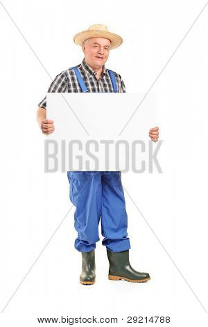 Full length portrait of a mature smiling farmer holding a banner isolated on white background