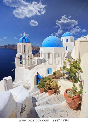 View of blue dome church in Oia village on Santorini island, Greece