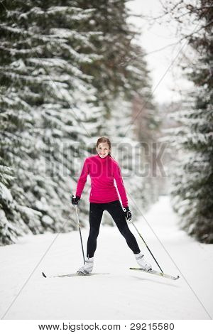 Cross-country skiing: young woman cross-country skiing on a lovely sunny winter day