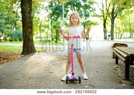 Small Child Learning To Ride