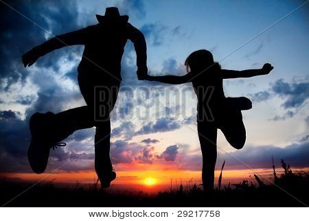 Couple Silhouette Running To The Sunset