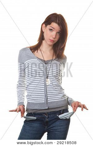 broke, young woman showing her empty pockets