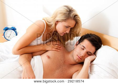 couple has fun in bed.