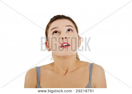 Frighten young girl with her eyes looking up, isolated on white background
