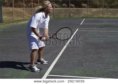 Tennis Player Stands At The Line, Ready For Action