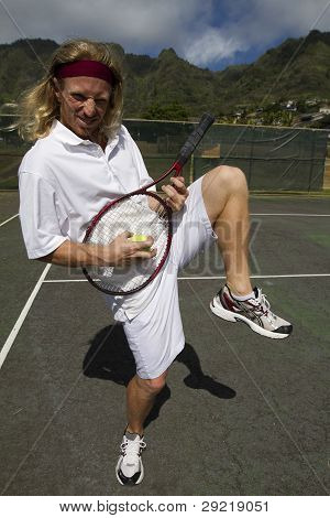 Tennis Player Gets Crazy And Plays Air Guitar With Racket