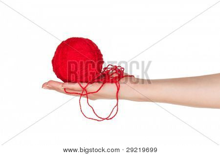 Woman hand with red ball of yarn for knitting isolated on white background