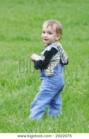 Cute Baby Boy On Grass Background