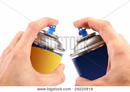 Two Graffiti Color Spray Cans In Hands