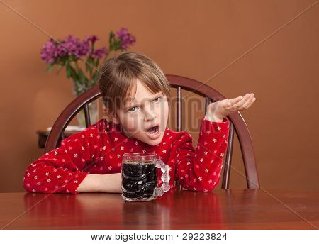 Incongruous shot of a 5 y/o girl with coffee