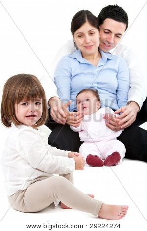 Unhappy Jealous Little Girl With Family
