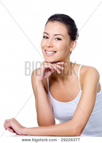 Happy Woman Sitting With Smile