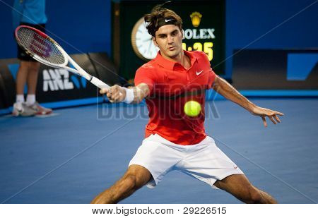 MELBOURNE - JANUARY 22: Roger Federer of Switzerland in his fourth round win over Bernard Tomic of Australia at the 2012 Australian Open on January 22, 2012 in Melbourne, Australia.
