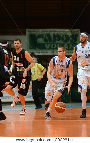 KAPOSVAR, HUNGARY - JANUARY 21: Nik Raivio (white 33) in action at a Hungarian National Championship basketball game with Kaposvar (white) vs. Szolnok (black) on January 21, 2012 in Kaposvar, Hungary.