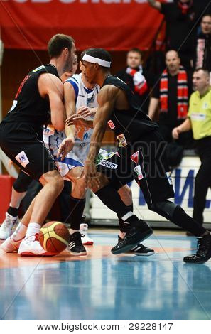 KAPOSVAR, HUNGARY - JANUARY 21: Unidentified players in action at a Hungarian National Championship basketball game with Kaposvar (white) vs. Szolnok (black) on January 21, 2012 in Kaposvar, Hungary.