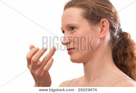Contact Lens On Finger Of Young Woman