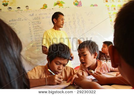 KO CHANG, THAILAND - JANUARY 6: Unknown children in lesson at school by project Cambodian Kids Care to help deprived children in deprived areas with education, on January 6, 2012 on Ko Chang, Thailand