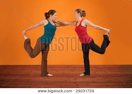 Two Women Perform Yoga
