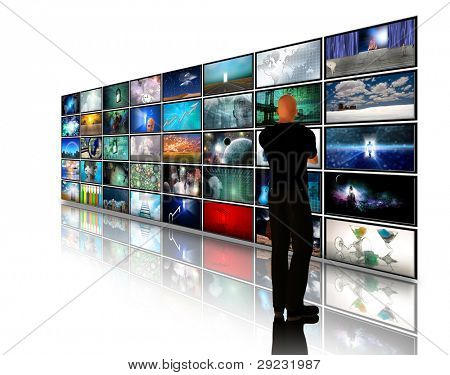 Man viewing video displays on white