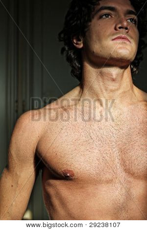 Sexy young man with naked torso