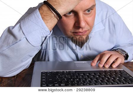 Worried man in front of computer