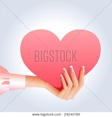 Female hand holds pinky heart