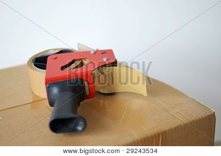 Cardboard Box And Tape Dispenser