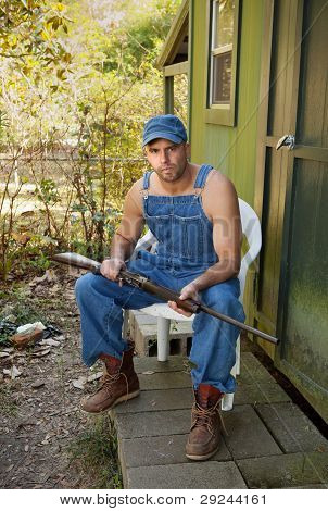 Country Man In Overalls With Shotgun