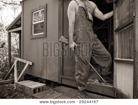 Backwoods Man With Shotgun And Overalls At Hunting Camp