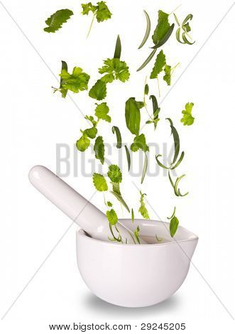 Herbs falling into mortar, isolated on white background