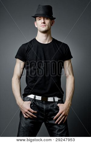 Young handsome guy posing in black t-shirt.