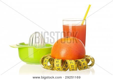 Fresh grapefruit juice with measure tape and grapefruit fruits on white background