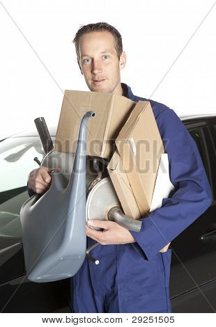 Mechanic Holding Cardboard Boxes And Oil Can