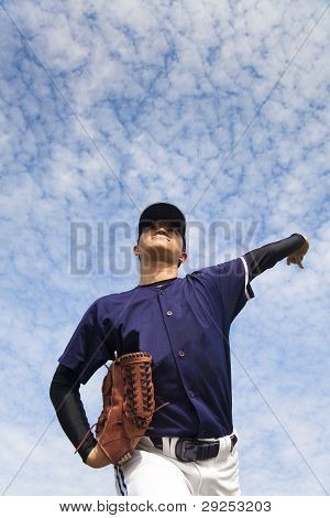 baseball pitcher with cloud backgroung pitch ball