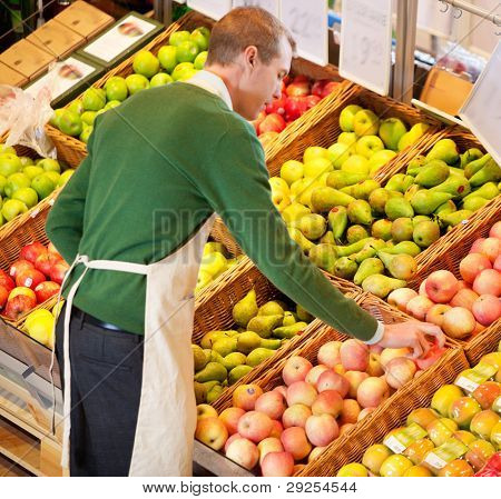 High angle view of store worker working in a grocery store