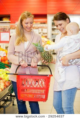 Mother and Child with friend in grocery store